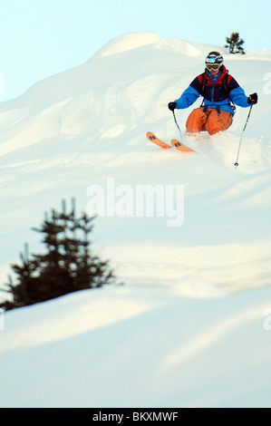 A skier off-piste in the French ski resort of Courchevel. - Stock Photo
