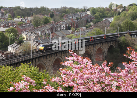 East Coast express passenger electric train crossing the railway viaduct at Durham, England, UK - Stock Photo