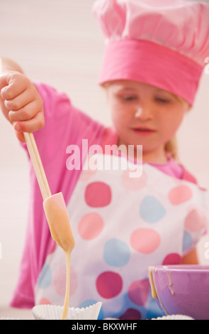 Close up of a young girl baking