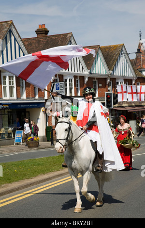 St George on horseback make her way up the High Street on St George's day, Haslemere, Surrey, England. - Stock Photo