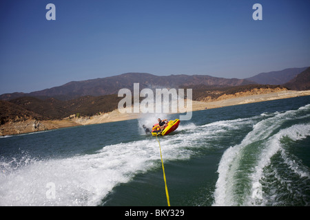 People tubing in Castaic Lake, Santa Clarita, California are about to flip over. - Stock Photo