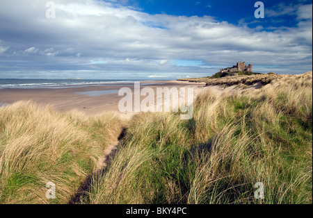 Bamburgh Castle pictured in late afternoon sunlight - Stock Photo