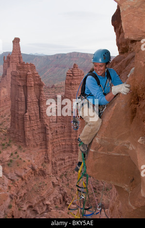 A woman rock climber in the Fisher Towers, Utah. - Stock Photo