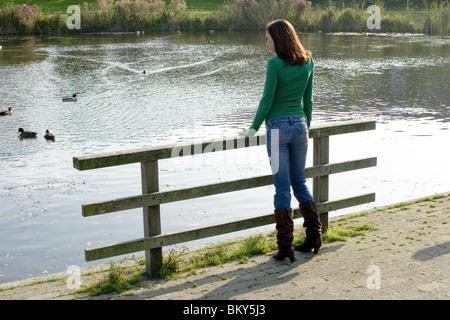 Young anonymous woman alone outdoors feeling lonely