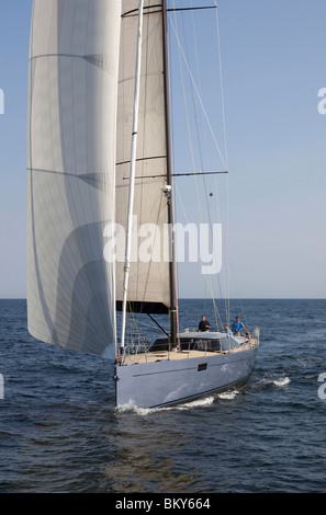 A crew races a modern ocean-going sailing yacht. - Stock Photo