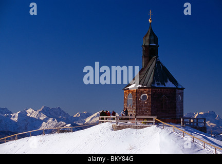 Chapel on snow covered Wallberg mountain under blue sky, Bavaria, Germany, Europe - Stock Photo