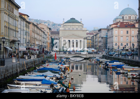 Boats on Canale Grande, church of St. Anthony in the background, Trieste, Friuli-Venezia Giulia, Upper Italy, Italy - Stock Photo