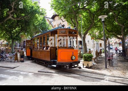 Nostalgic train Red Flash beneath some trees at Sóller, Mallorca, Balearic Islands, Spain, Europe - Stock Photo