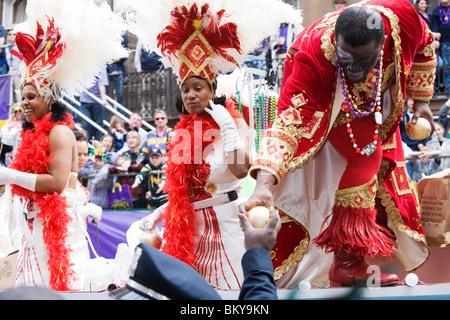 Carnival Parade on Mardi Gras, French Quarter, New Orleans, Louisiana, USA - Stock Photo