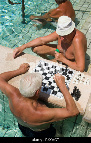 Men playing chess in a thermal bath, Men playing chess in a thermal bath of the Szechenyi-baths, Pest, Budapest, - Stock Photo