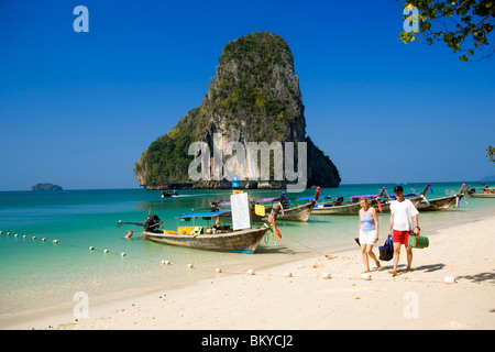 People, Trips offered, Anchored boats, chalk cliff in background, Phra Nang Beach, Laem Phra Nang, Railay, Krabi, - Stock Photo
