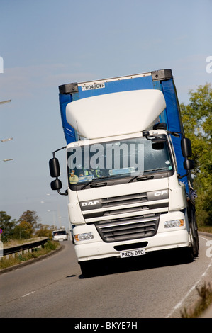 2009 DAF CF lorry travelling on a dual carriageway in England. - Stock Photo