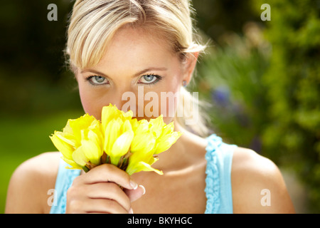 Girl with flowers - Stock Photo