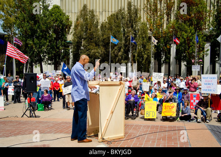 An angry African American speaker harangues the crowd at a 'Tea Party' rally on April 15 (Tax Day) in Santa Ana, - Stock Photo