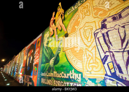 Political murals on the Falls Road in the traditionally catholic area of Belfast, Northern Ireland - Stock Photo