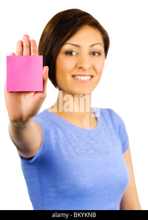Young woman has a pink sticky note on the palm of her outstretched hand - Stock Photo