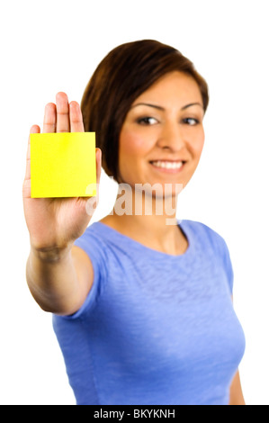 Young woman has a yellow sticky note on the palm of her outstretched hand - Stock Photo