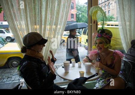 Cirque du Soleil performers promote the Banana Shpeel show at the Magnolia Bakery - Stock Photo