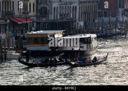 Buildings ferries and gondolas along the Grand Canal in Venice, Italy - Stock Photo