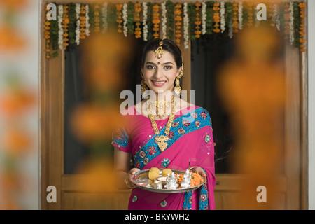 Woman holding Diwali thali - Stock Photo