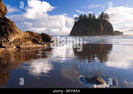 Low tide reflections of Crying Lady Rock at Washington's Second Beach in Olympic National Park. - Stock Photo