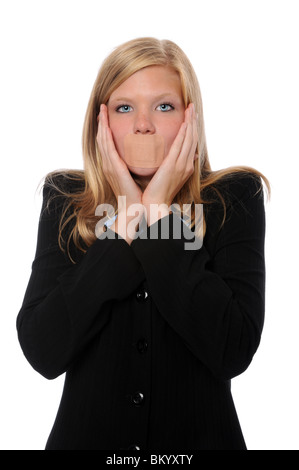 Businesswoman with adhesive bandage on mouth and hands on side of face - Stock Photo