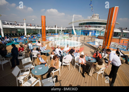 Pool Bar & Main Pool Area on Deck 11, Freedom of the Seas Cruise Ship, Royal Caribbean International Cruise Line - Stock Photo
