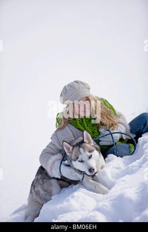 Girl and siberian husky - Stock Photo