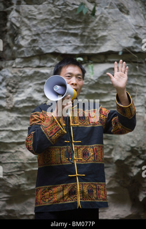 Singing River Guide in Emerald Green Gorge, Daning River Lesser Gorges, near Wushan, China - Stock Photo