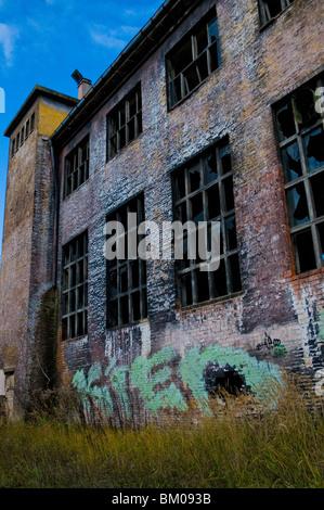 Derelict boiler house in tank barracks - Stock Photo