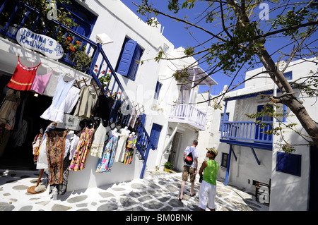 People in the narrow lanes of town, island of Mykonos, the Cyclades, Greece, Europe - Stock Photo