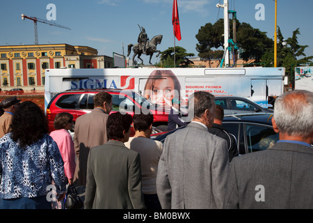 People wait to cross the street at Skanderbeg Square in Tirana, the capital of Albania. - Stock Photo