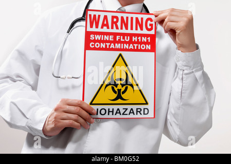 Doctor showing a Biohazard warning sign - Stock Photo