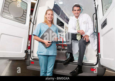 Doctor with a female nurse in an ambulance - Stock Photo