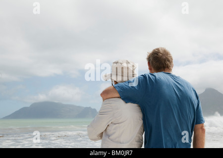 Mature man hugging mature woman - Stock Photo