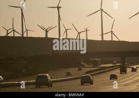 Windmill farm and traffic along Interstate Highway 10 in Palm Springs Coachella Valley Southern California US - Stock Photo