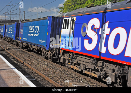 Stobart Rail locomotive No. 92017 'Bart the Engine' hauling Tesco Less CO2 freight. West Coast Main Line. Oxenholme, - Stock Photo