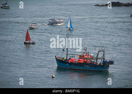 Fishing boat and different leisure craft, Salcombe, Devon, UK - Stock Photo