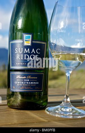 Bottle and glass of still white Okanagan Valley Gewurztraminer wine made in Summerland BC - Stock Photo
