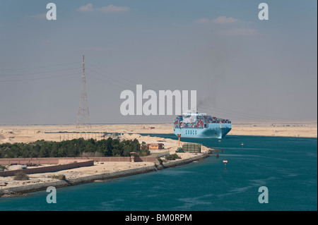 A Container Ship Transits Through The Suez Canal, Egypt - Stock Photo