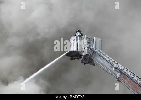 firefighter battling a smoky fire