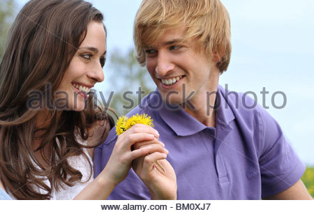 young couple on a summer meadow - Stock Photo