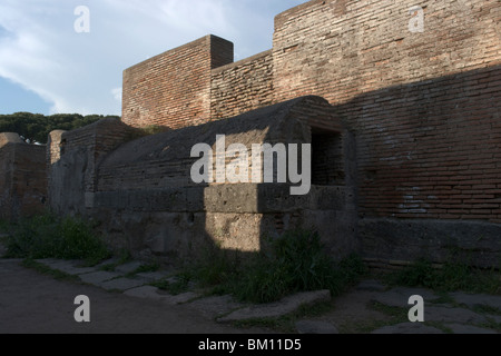 Ostia Antica, Rome. An ancient Roman public covered fountain in a street which is nowadays called Via della Fontana. - Stock Photo