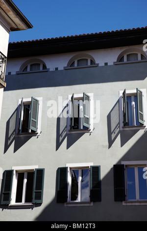 Open windows in Lugano, Switzerland - Stock Photo