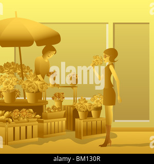 Woman buying a bouquet of flowers from a flower shop - Stock Photo