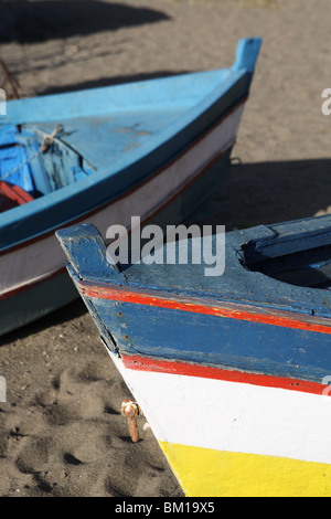 The bows of two wooden fishing boats seen on the beach at Torremolinos, Spain, Europe - Stock Photo