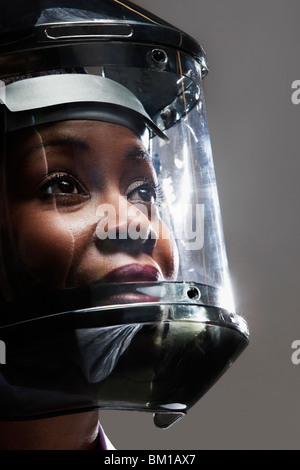 Female doctor wearing a protective gear in a laboratory - Stock Photo