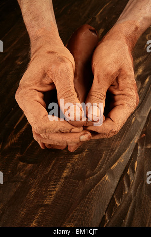 pottery craftmanship potter craftman hands working red clay - Stock Photo