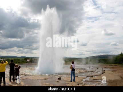 Strokkur geyser in eruption, Geysir geothermal basin, southwest area, Iceland, Polar Regions - Stock Photo
