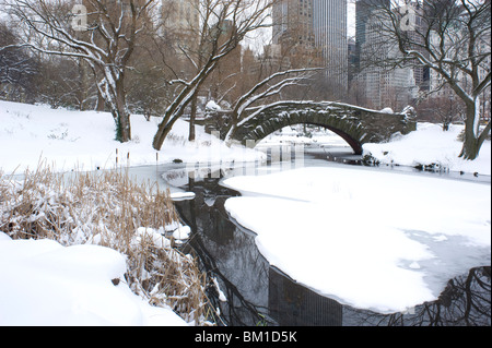 The Gapstow Bridge in early morning after a snowfall in Central Park, New York State, New York City, United States - Stock Photo